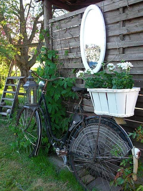 old bike turned Turn your old bike into an original garden decoration in decoration 2  with reused repurposed planter garden decoration bike