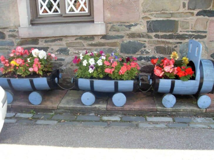 Recycled Barrels into a Train Planter - flowers-plants-planters
