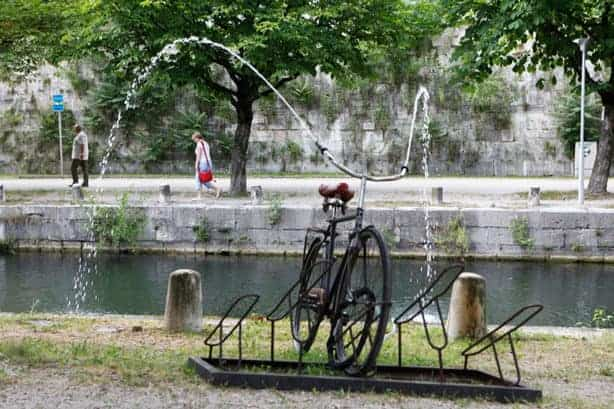 Reclaimed Bike Used As A Fountain In A Public Art Installation - garden-decor