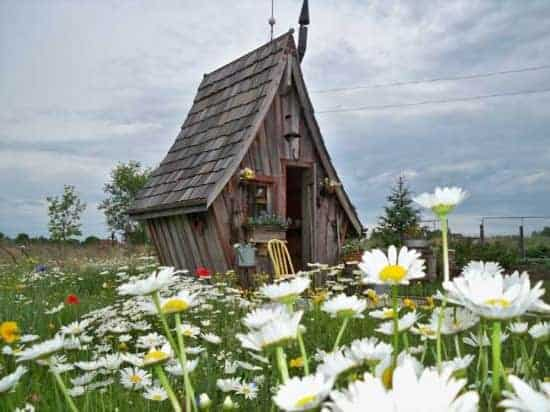 The rustic way whimsical huts built with reclaimed wood for Whimsical playhouses