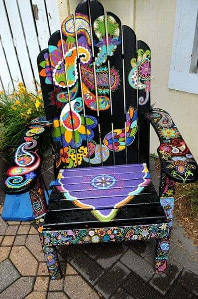 "A chair titled ""Playful Paisley"" by Ashley Hadfield which sits in front of Eichten's Market and Bistro in Center City is part of the Highway 8 Chairs project in Chisago County that has 37 Adirondack-style chairs, each painted by an area artist, along the stretch of highway between Chisago City and Taylors Falls Friday July 26, 2013.The project was launched by a local nonprofit group to draw visitors to businesses who have suffered during recent road work. (Pioneer Press: Jean Pieri)"