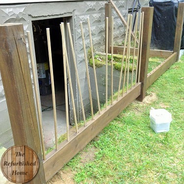 Make your Repurposed Wine Bottle Fence4