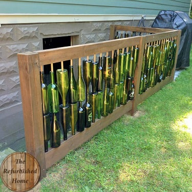 Make your Repurposed Wine Bottle Fence9