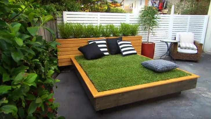 10 Outdoor Daybeds for a Lazy Afternoon include this grassy day bed!