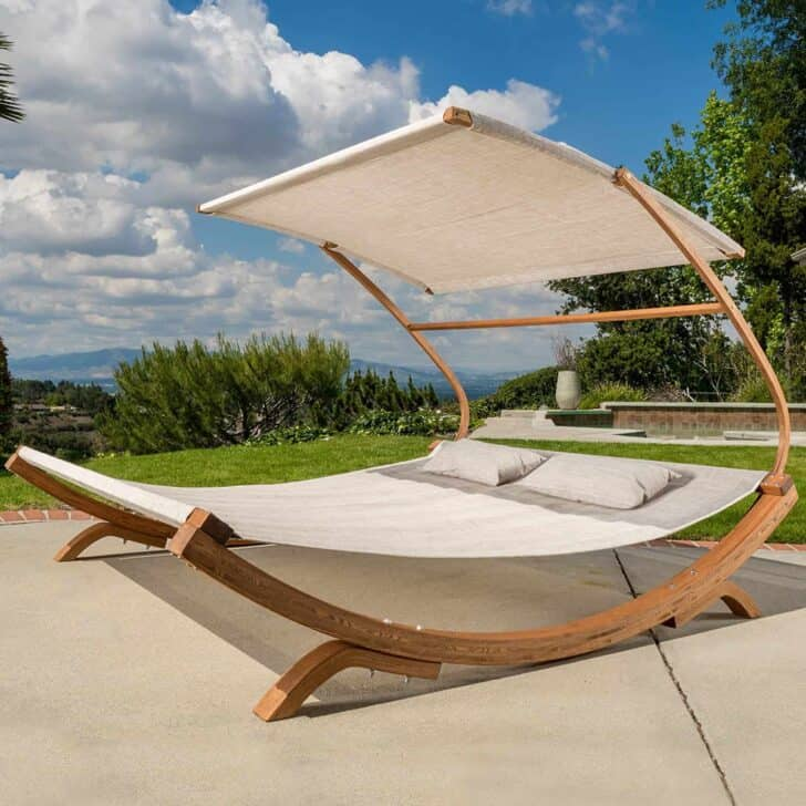 Ultra-modern Outdoor Daybeds like this design with bent wood, sails, and a wide, inviting hammock look like it could be gliding over a glassy lake instead of your back yard!