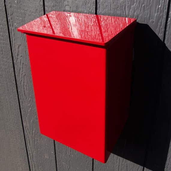 This Wall-Mounted Mailbox is powder-coated in red for years of beauty and durability.