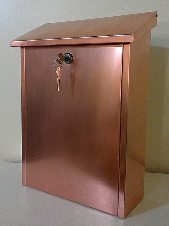 Strong and weather resistant, this Wall-Mounted Mailbox with a lock and made of copper is a brilliant choice!