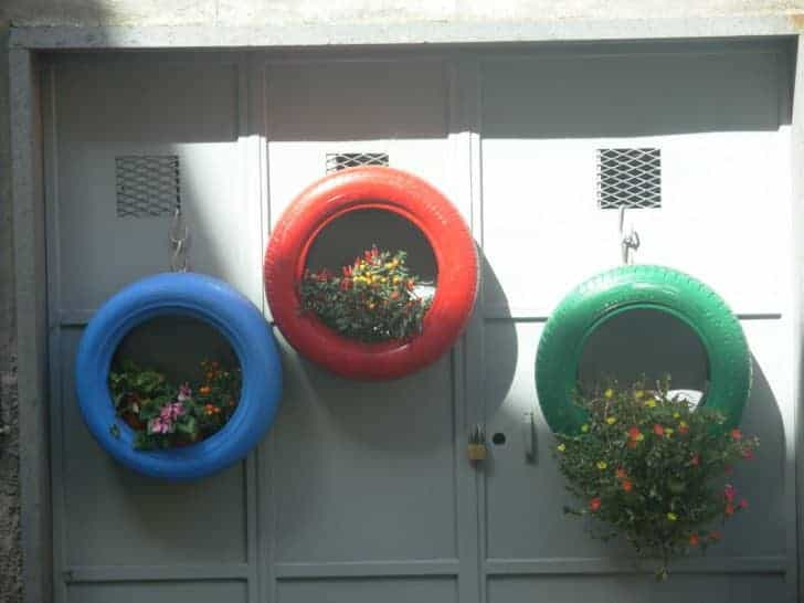 Tire Hanging Garden is made by upcycling an old tire and planting whatever you like, such as succulents, annuals, etc. inside and hanging it on a wall.
